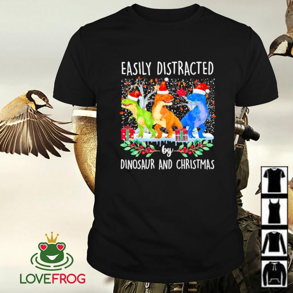 Santa easily distracted by dinosaur and Christmas shirt